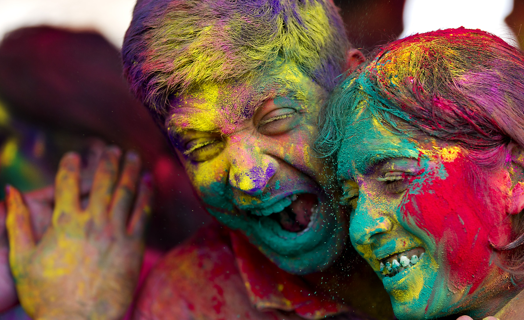 (USE THIS IMAGE) 30 MAR 2013: Nishant Bhargava, left, and Smriti Rai, right, laugh as they are painted with gulal, color dyes, as the celebrate the during Holi, the festival of colors held at the Austin Hindu Temple and Community Center in Austin, Texas, on Saturday, March 30, 2013. The Holi Festival is a celebration welcoming the arrival of Spring. RODOLFO GONZALEZ / AMERICAN-STATESMAN