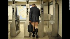 A rider enters the New York subway in his underwear as he takes part in the 2014 No Pants Subway Ride on January 12, 2014. Started by Improv Everywhere, the goal is for riders to get on the subway train dressed in normal winter clothes without pants and keep a straight face. AFP PHOTO / TIMOTHY CLARY (Photo credit should read TIMOTHY A. CLARY/AFP/Getty Images)